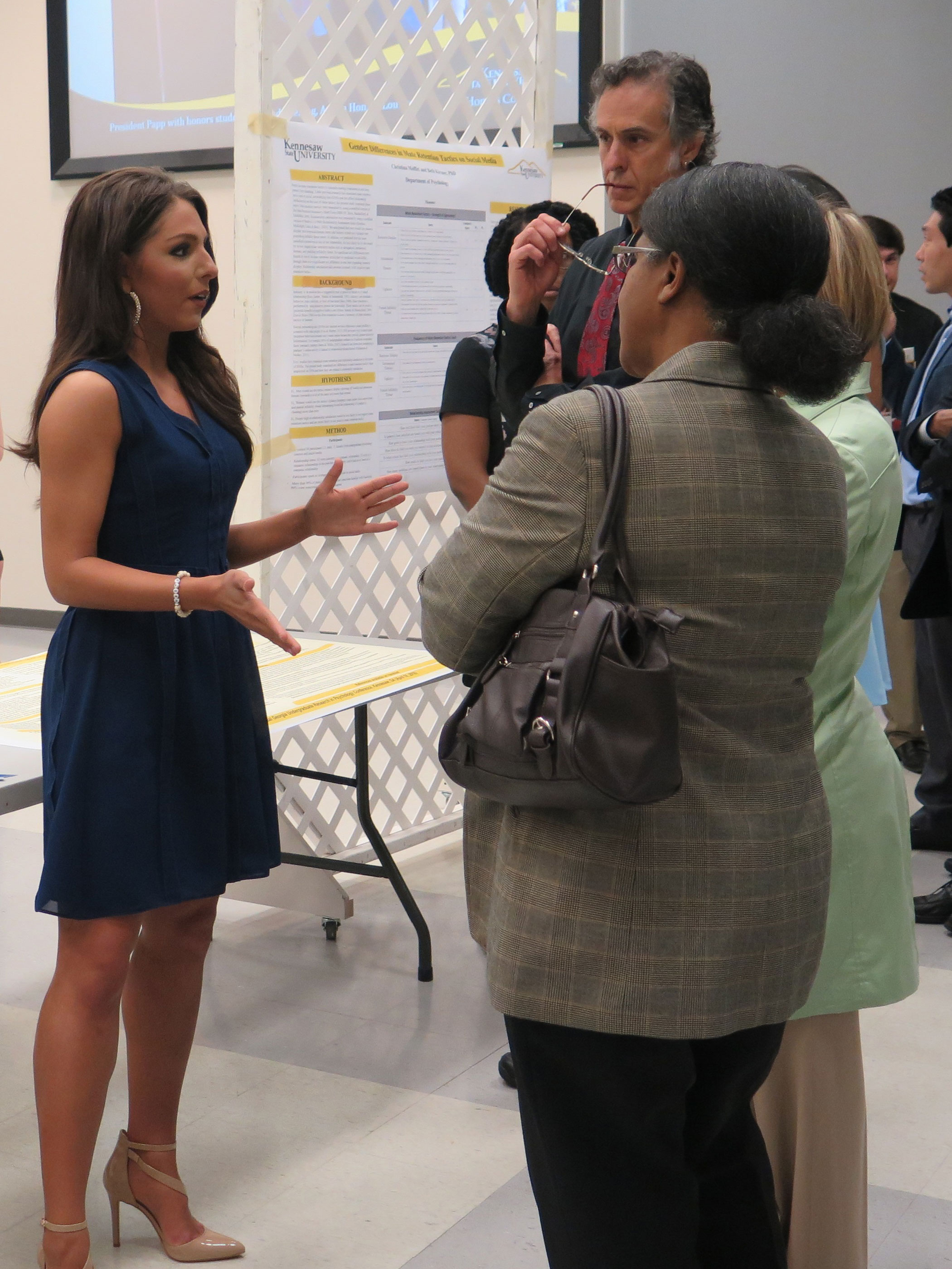 Brooke Doss talks to visitors